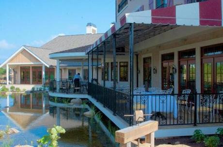 The Bistro & Wine Bar overlooks a man-made pond.